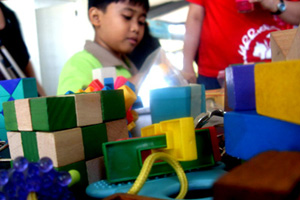 Toy puzzles keep boy genius busy.